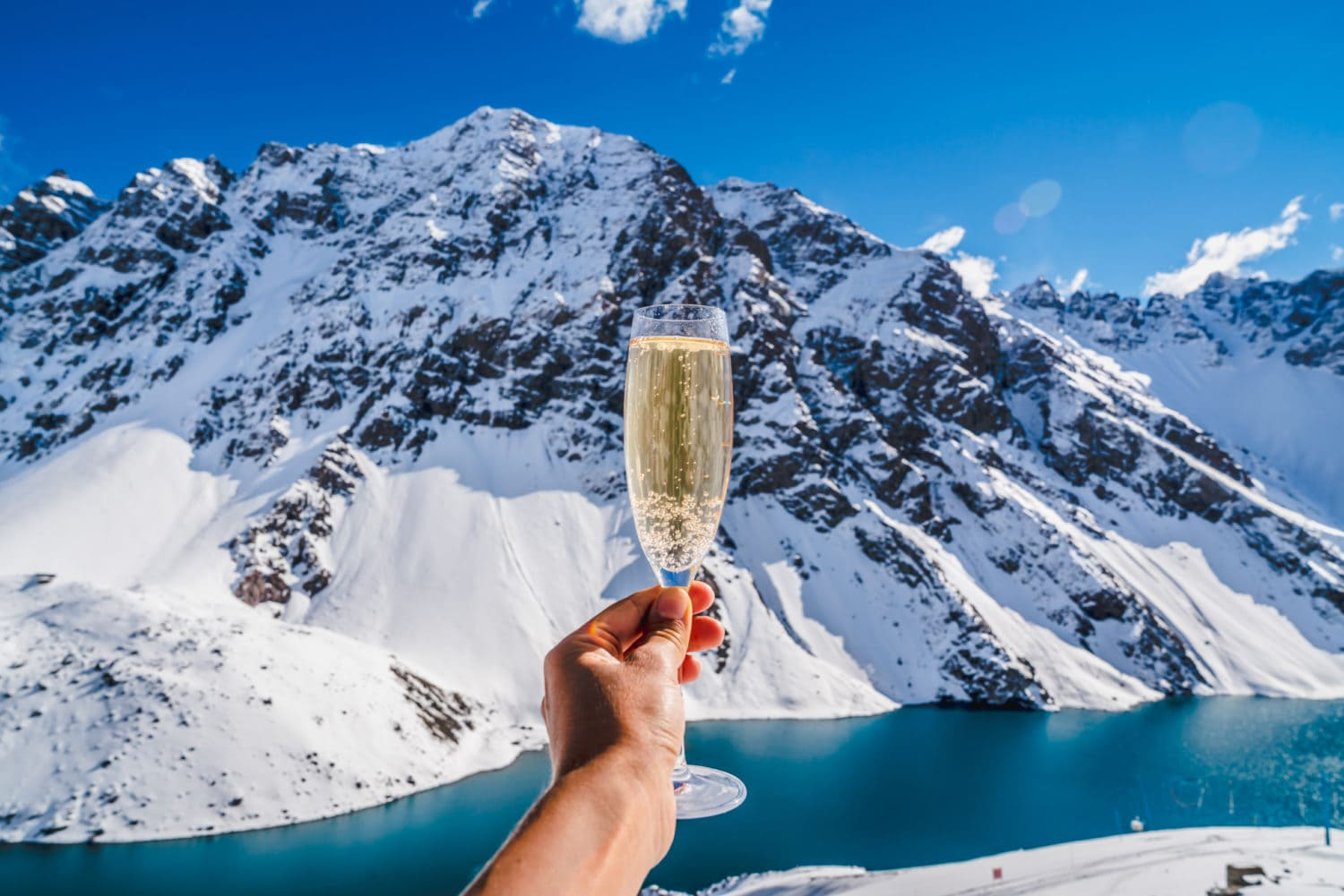 Champagne and snow - Snow Champagne Background Mountain. Snow Ski Luxury Resort & Blue Crystal Background. Winter Plateau, Austria. Snowboarding in Winter Holidays. Adventure. Snow Mountain Alps from Peak. Winter Ski.